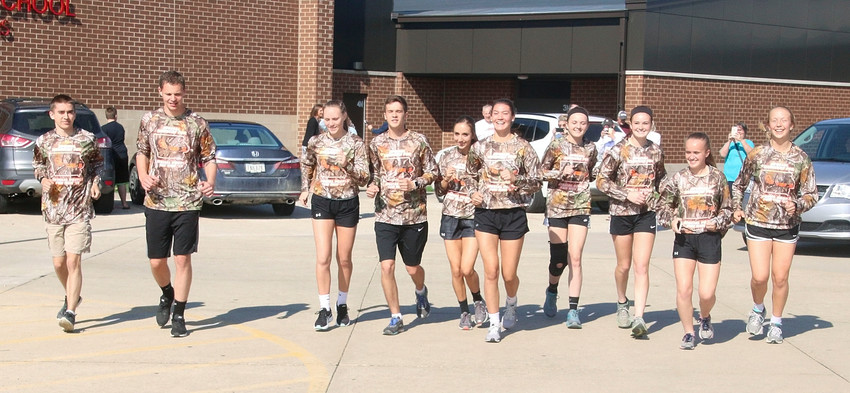North Scott's Special Runners were all smiles on Wednesday, May 16, when they took off for Ames. They took turns running two-mile legs to complete the 199-mile trek. From left: David Boeteger, Nick Upmeyer, Bailee Kroeger, Nick Boddicker, Paige Durant, Grace Hansel, Chloe Engelbrecht, Emily Kundel, Zoe Warm and Breanna Kilburg.