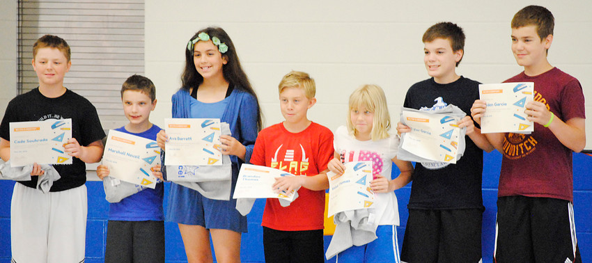 Wilton Elementary School presented students with perfect school attendance this year a certificate and T-shirt during the last day of school assembly on May 23. Pictured from left are Cade Souhrada, Marshall Neuzil, Ava Barrett, Brandon Thomas, Kelsie Thomas, Tyler Garcia and Kaiden Garcia, all of whom never missed a day of school.