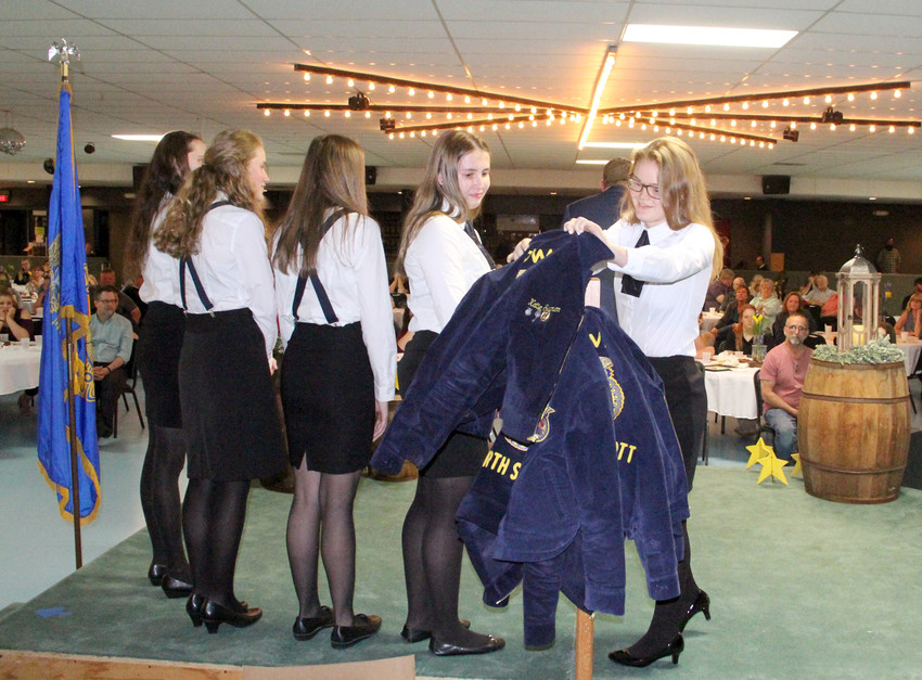 Katie Seeman wrapped up the 2017-18 FFA year by joining this year's officers hanging their jackets at the North Scott ag department's May 15 banquet at the Eldridge Community Center.