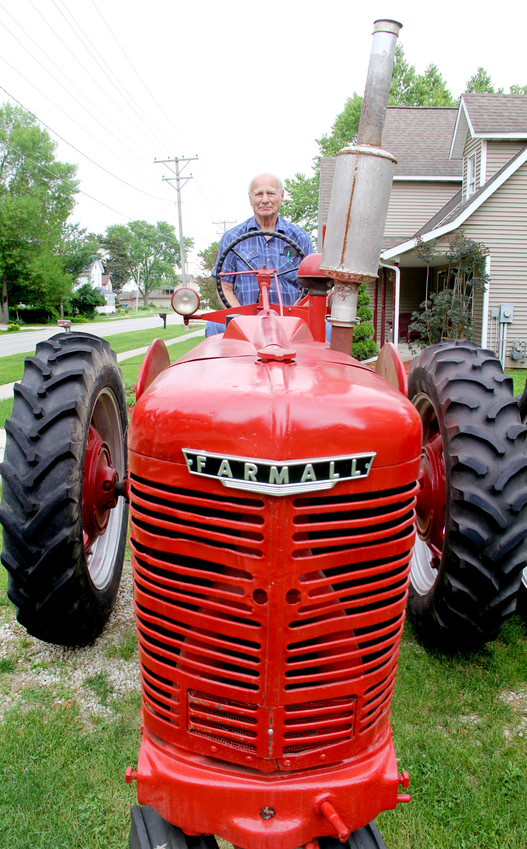 Malvern Kirby sits atop the Farmall M tractor he'll pilot on the WHO Tractor Ride across Scott County.