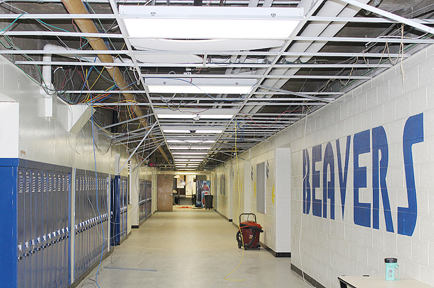 A new ceiling is being installed in the lower level of Wilton High School, just outside of the old cafeteria, which now houses new locker rooms.