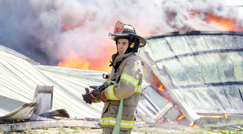 Clayton Schoenthaler takes aim at a 2017 barn fire north of Long Grove.