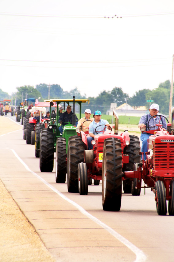 The WHO Tractor Ride arrives in Eldridge on East Leclaire Road about 11:20 a.m. Monday.