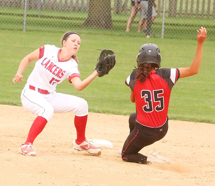 North Scott shortstop Taylor Robertson takes the throw from catcher Rachel Anderson to catch Assumption's Nicole Yoder on this stolen base attempt.