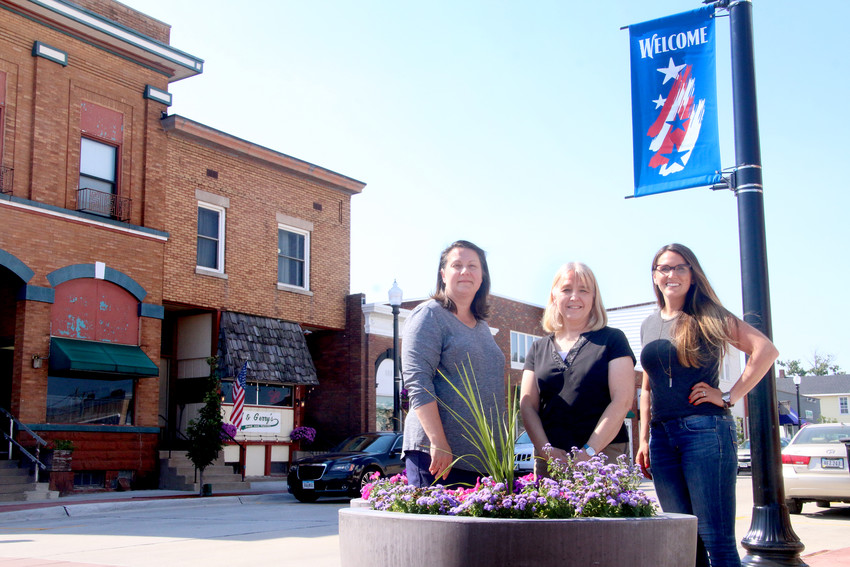 Eldridge Summer Festival Committee members Julie Wall, Marilee Schafer and Mariah Danielson pose amid the $1 million makeover of Eldridge's Second Street.