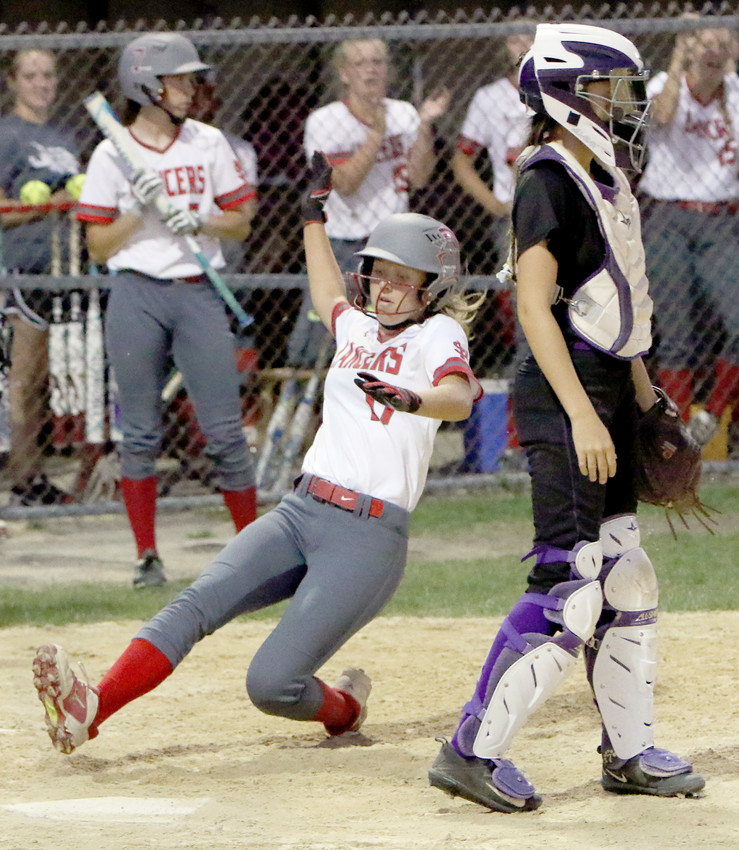 North Scott's Taylor Robertson slides into home plate behind Keokuk catcher Jakala Hall to score a run in the seventh inning for the Lady Lancers during the substate Class 3A girls softball game against the Keokuk Chiefs on Friday, July 7, 2018.