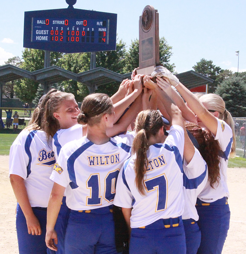 The Beavers raise the trophy they received in Fort Dodge at the state softball tournament.