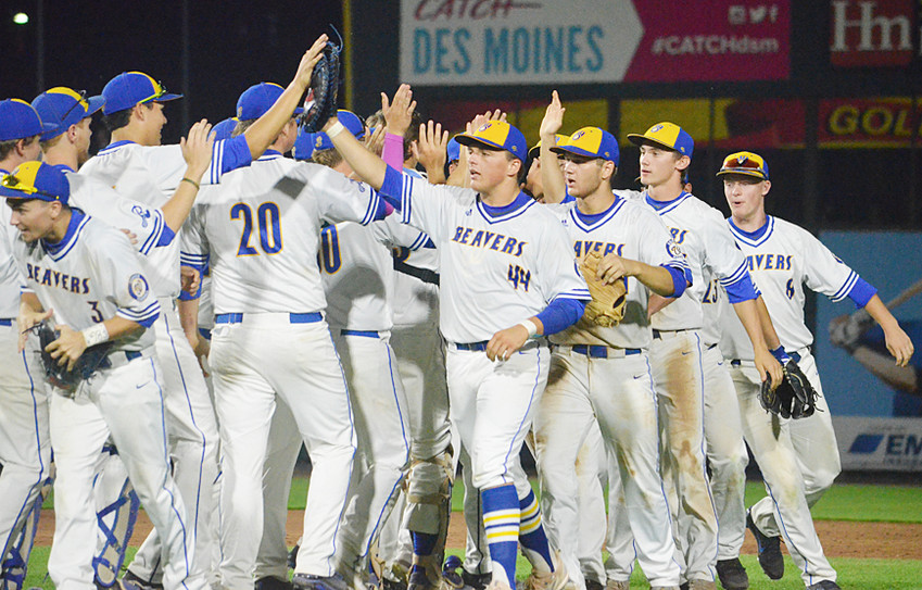 The Wilton baseball team gathers after its 3-2 win over Denver in opening state tournament action July 23.