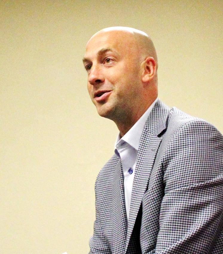 QC Chamber of Commerce Director Paul Rumler addresses the Eldridge City Council Monday.
