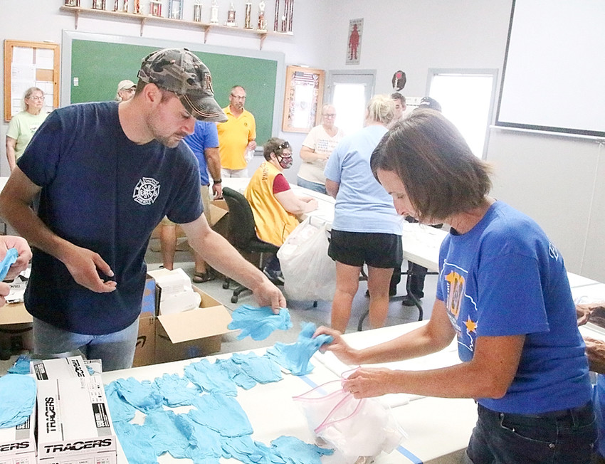 Volunteers from around rural Scott County, including area firefighters and members of the Eldridge, Park View and Long Grove Lions Clubs, met at the Long Grove Fire Station Saturday morning to pack trauma kits.