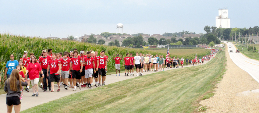 """More than 2,000 North Scott area residents formed a line on the rec trail from Eldridge to Long Grove for a """"Night Out"""" observation on Tuesday, Aug. 7."""