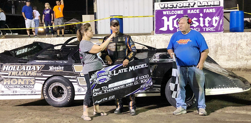 After a summer of no stock car racing at West Liberty Raceway, a Mid Summer Madness event was held Aug. 11. Sponsored by Bud Kile, there were reports of around 3,000 in the stands and 700 more in the pit area. Concessions ran out of food and drinks due to the large turnout and around 143 cars showed up for races in five classes. Former Wilton grad Chad Holladay (pictured above) won the $1,000 Late Model feature.