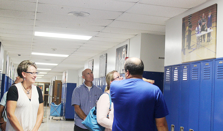 Members of the Durant school board, including board president Julie Rivera (left), and members of the school's administration, including new superintendent Joe Burnett (middle) were given a tour of summer upgrades made to the Durant Middle School. Updates included new lockers and canvas student life photos posted in the hallways.