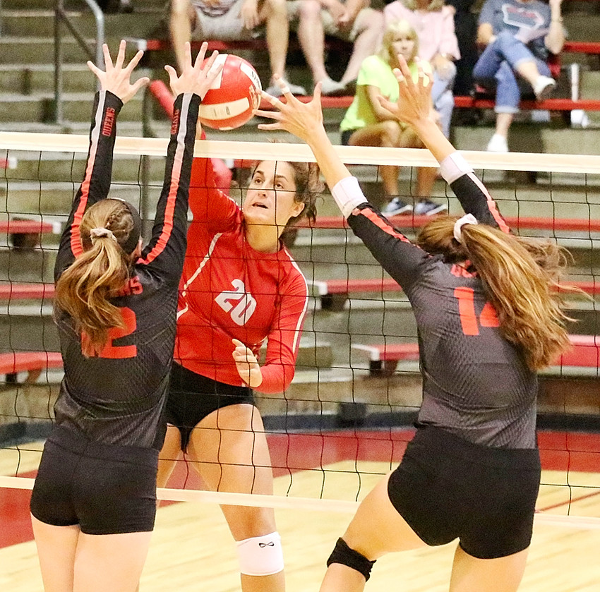 In one of the most exciting sets you'll ever see, Lancer junior Grace Boffeli delivers a key kill that gave her team a 31-30 lead in the third set against Clinton on Tuesday, Aug. 22.