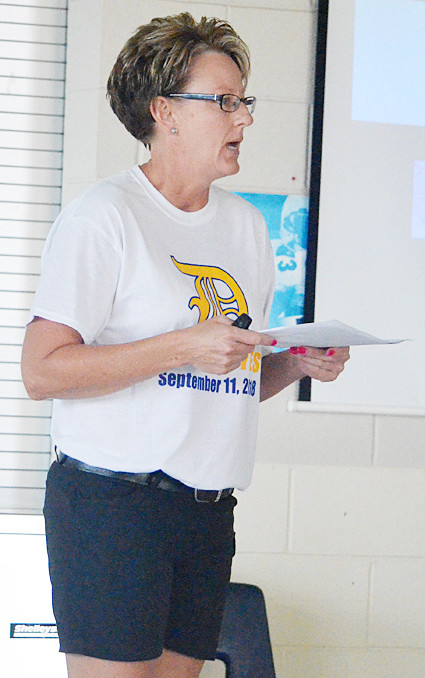 Durant school board president Julie Rivera addresses an audience of around 20 at a public forum held in the cafeteria Aug. 27. The forum discussed the district's proposed $10.8 million bond project, which has a Sept. 11 vote.