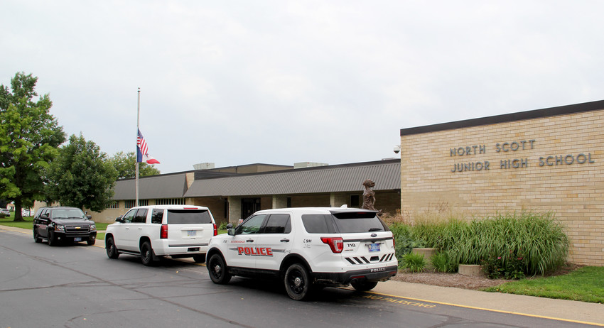 Eldridge Police vehicles are seen outside North Scott Junior High Friday morning, Aug. 31. The Junior High and High School were placed on lockdown after it was discovered a student brought a gun to school.