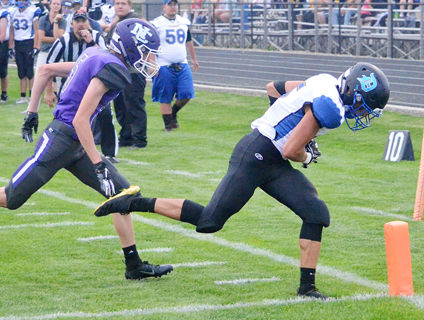 Mason Compton had four touchdowns in a 49-18 win over North Cedar. He had three receiving TDs and took a kickoff to the house.