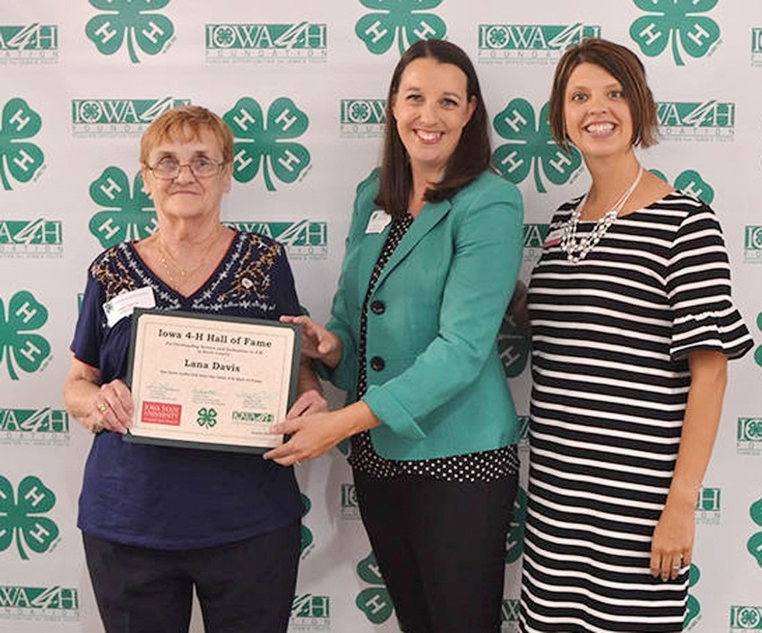 Iowa 4-H Hall of Fame inductee Lana Davis is recognized by 4-H Foundation director Emily Saveraid (center) and Volunteer Development specialist Tillie Good.