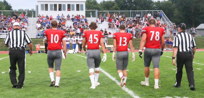 North Scott captains Nile McLaughlin, Mason Watts, Carson Rollinger and Brady Ernst take the field for the coin toss.