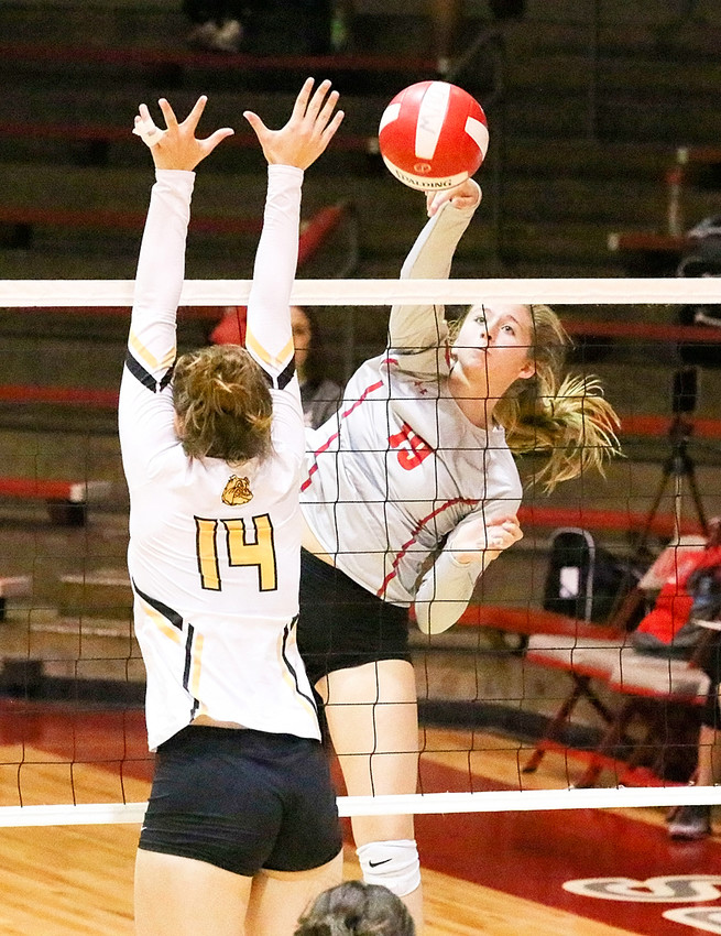 Lancer junior Emma Powell kept her eye on the ball as she hammered home a kill against Bettendorf on Saturday.