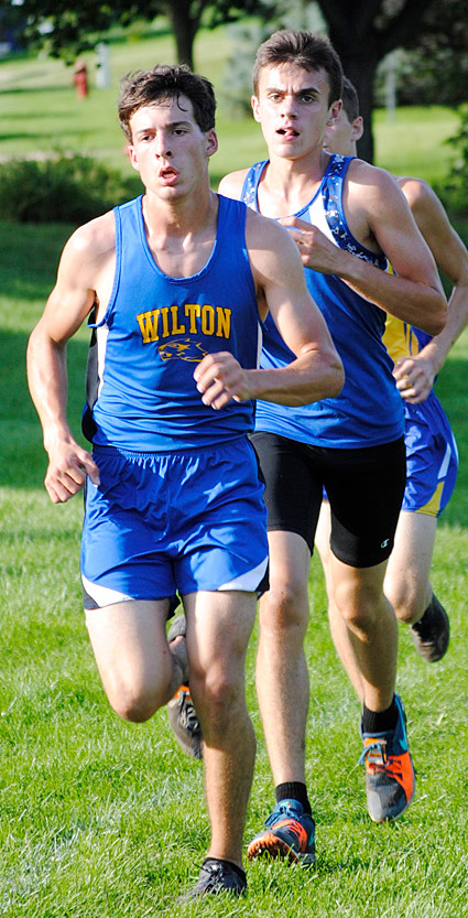 Wilton's Zach Hein and Durant's Jack Voss are shown in the boys' race.