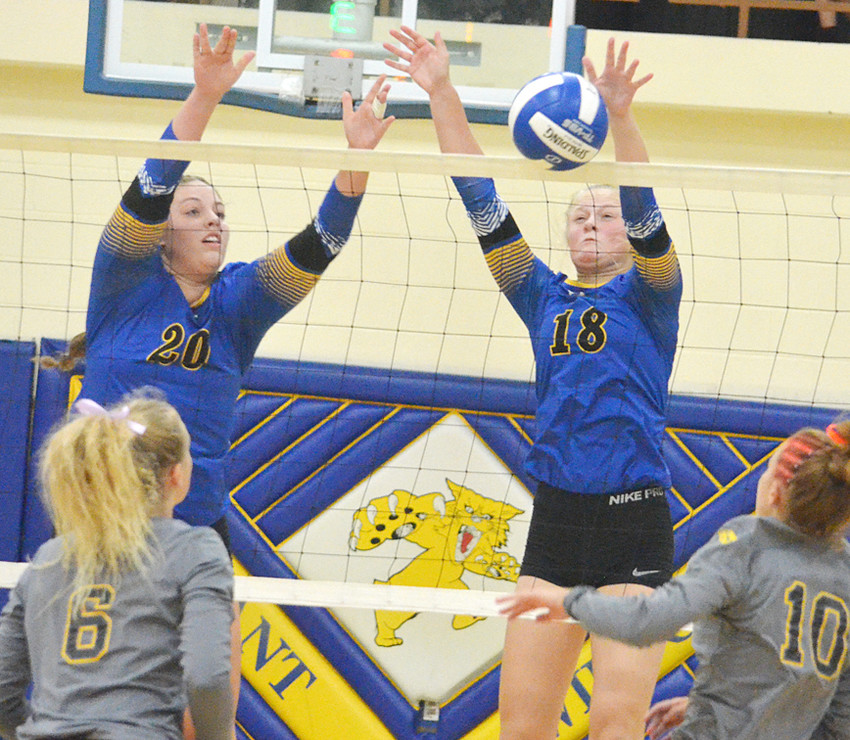 Mallory Warner and Kamryn Meyer look for a block at net against Tipton.