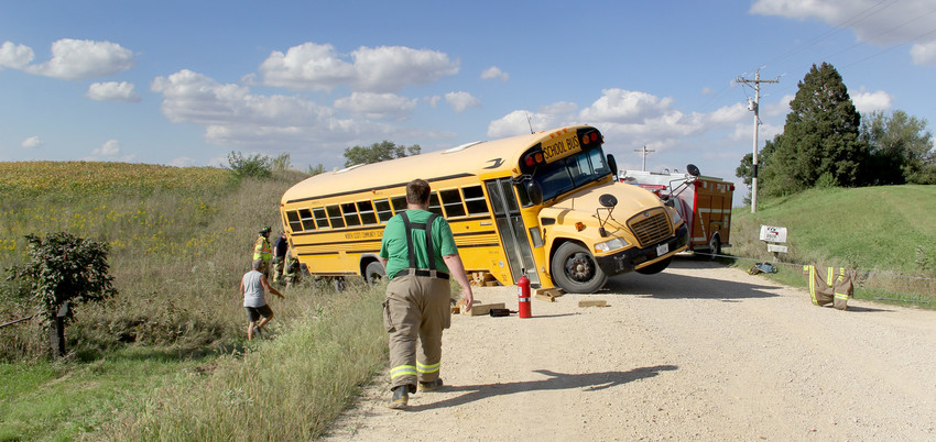 A winch pulls a North Scott school bus out of a 130th Avenue ditch, Friday, Sept. 14 near Donahue.