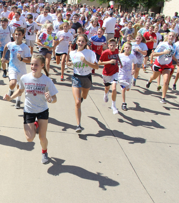 North Scott Junior High spilled color through Eldridge streets during the annual Color Run.