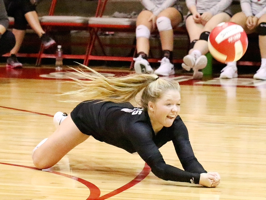 Spending time on the floor is a common occurrence for Lancer senior Maddie Allison, who leads the team with 168 digs.