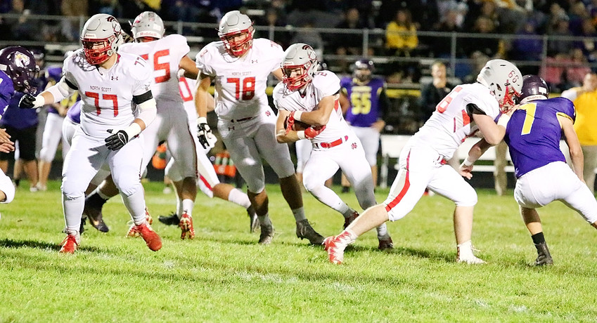 Jacob Porth finds a hole behind the blocking of Gordy Field (77), Jackson Stoefen (55), Brady Ernst (78) and Dylan Spiers (66).