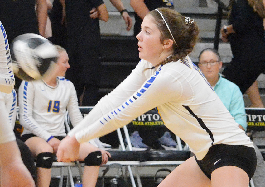 Alexa Garvin is shown receiving serve in action at Tipton.