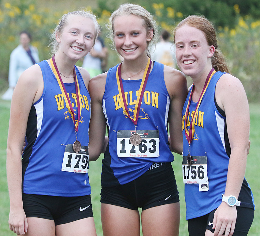 Wilton cross country runners Emmy Drake, Linsey Ford and Abby Brown finished in the top 15 to medal at Mount Pleasant.
