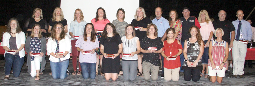 10 years: Back row: Angie Branstetter, Tracy Denahy, Stephanie Fahrenkrog, Andrea Kinzenbaw, Noel Price, Kate Meinecke, Dan House, Jennifer Santee, Bruce Conklin, Deana Sorensen, Robert Pfiffner and Shane Knoche.  Front row: Ashley Laber, Megan Knight, Christine LeDoux, Kaitlyn Lilly, Michelle Rohlf, Ashley Neilson, Karin Schmeink, Karyn Sindt, Jennifer Unwin and Vinnie Smith.