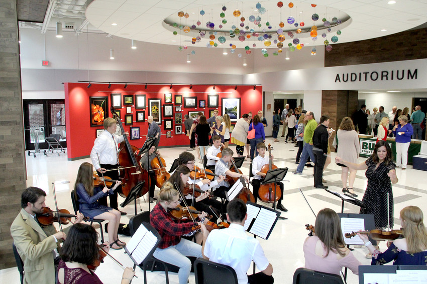 The North Scott orchestra performs during an open house for the newly remodeled North Scott Fine Arts Auditorium.