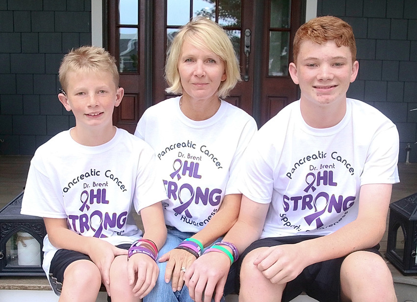 "Peggy Ohl poses with sons Charlie and Tom. They established the endowment to support others suffering with the disease that took their husband and father. ""I want to give back a tiny bit of what was given to us,"" Peggy Ohl said."
