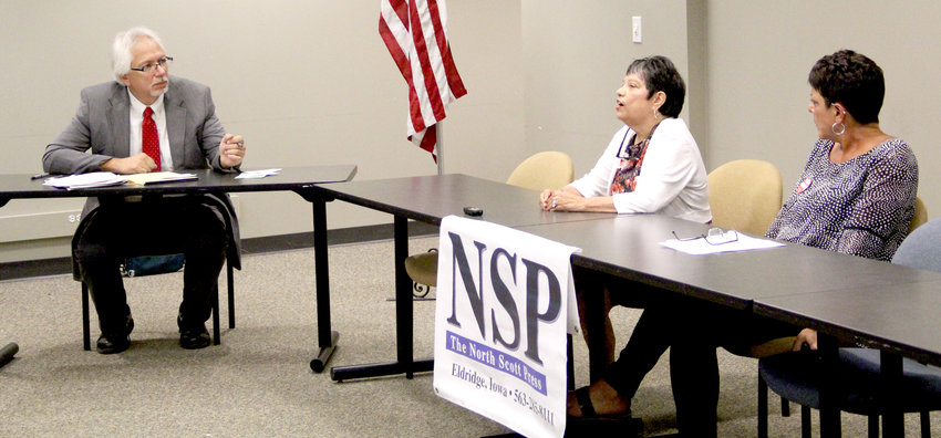 Scott County Recorder Rita Vargas, center, and Republican challenger Mindy Ortiz Carpenter, answer questions from NSP assistant editor Mark Ridolfi at the NSP's Sept. 20 candidate forum.