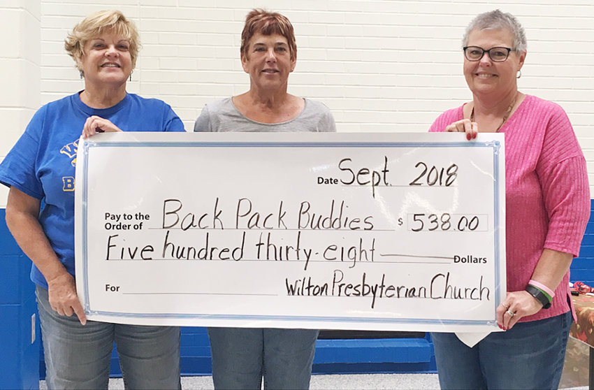 As part of their mission program, the Wilton First Presbyterian Church held a taco night in August to support the Wilton School Backpack Program. A check for $538 was presented to the school to help purchase supplies for the program. Pictured from left includes Terri Becker, Becky Hansen and Terri Denkman.