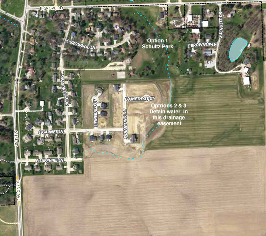 This map of stormwater drainage options shows the Winfield Estates addition next to the farm field.
