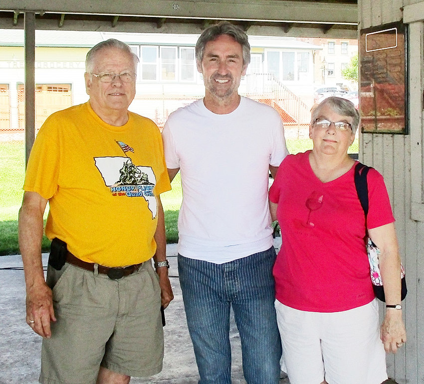 Duane and Lynda Miller pose with American Picker Mike Wolfe on a field reporting trip for OUR IOWA magazine.