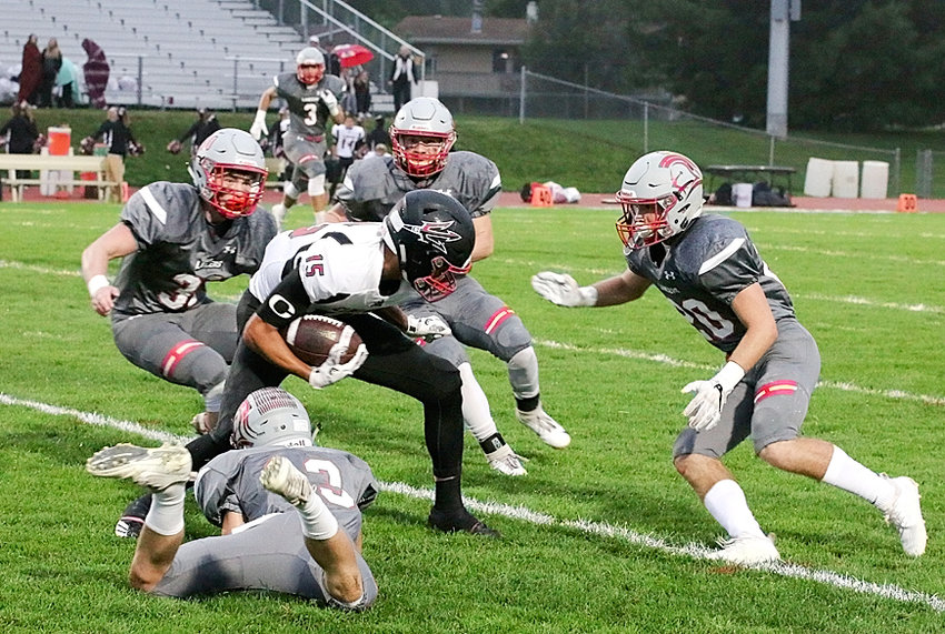 Displaying gang tackling to perfection, Lancers (clockwise from bottom) Carson Rollinger, Sam Erickson, Garrett Willey and Nate Link team up to bring down Clinton's L.J. Henderson.