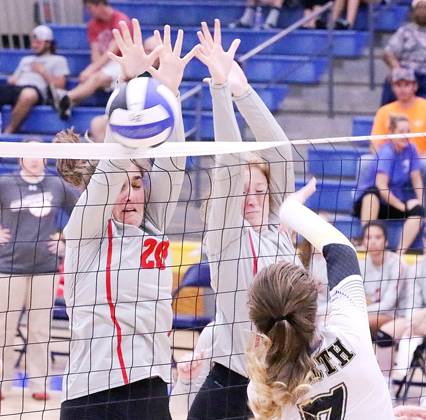 North Scott controlled the net all night in its Monday win over Davenport North, thanks in part to the blocks put up by juniors Grace Boffeli (l) and Kendal McNaull.