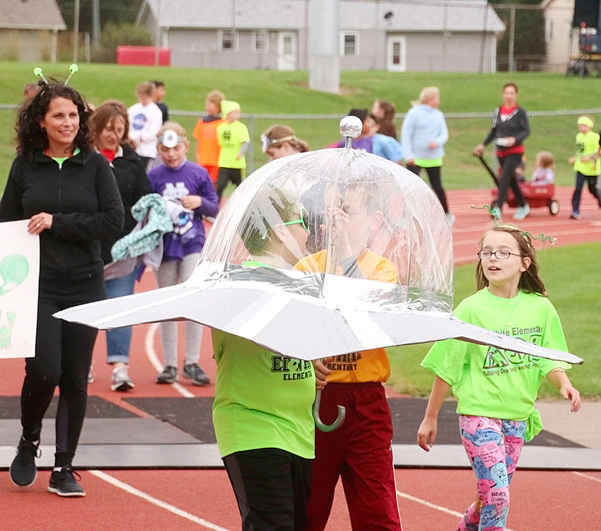 Mother Nature didn't exactly cooperate, but students at Ed White Elementary in Eldridge made the best of the situation at the school's annual Fun Run on Friday, Sept. 28.