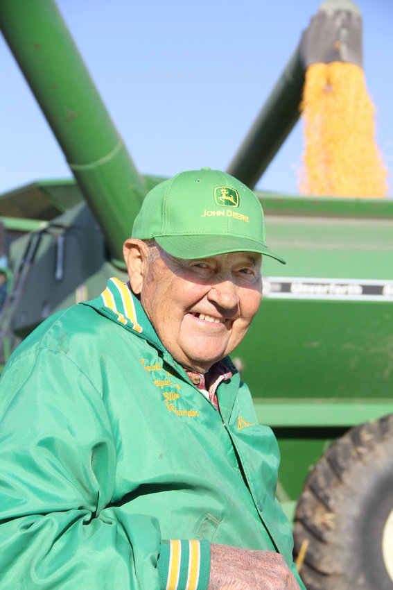 Harold Scherer poses during harvest at his Utica Ridge Road home.