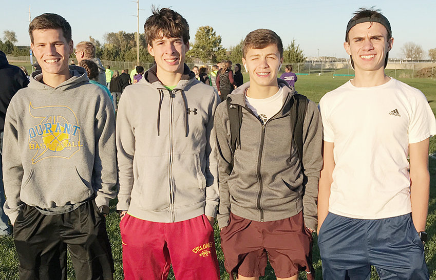 Four area cross country runners (from left) — Easton Botkins of Durant, Zach Hein of Wilton, Buddy Darting of Wilton and Jack Voss of Durant — qualified for the Class 1A state meet in Fort Dodge Oct. 27 with top 15 performances at the Iowa City state qualifying meet Oct. 18.