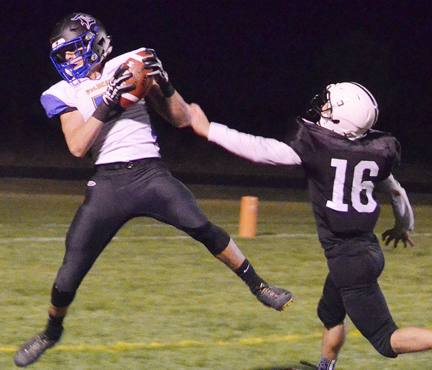 Durant's Mason Compton (left) makes one of his six catches in road action at Pekin Oct. 19. Compton leads Class A in receiving with 961 yards.