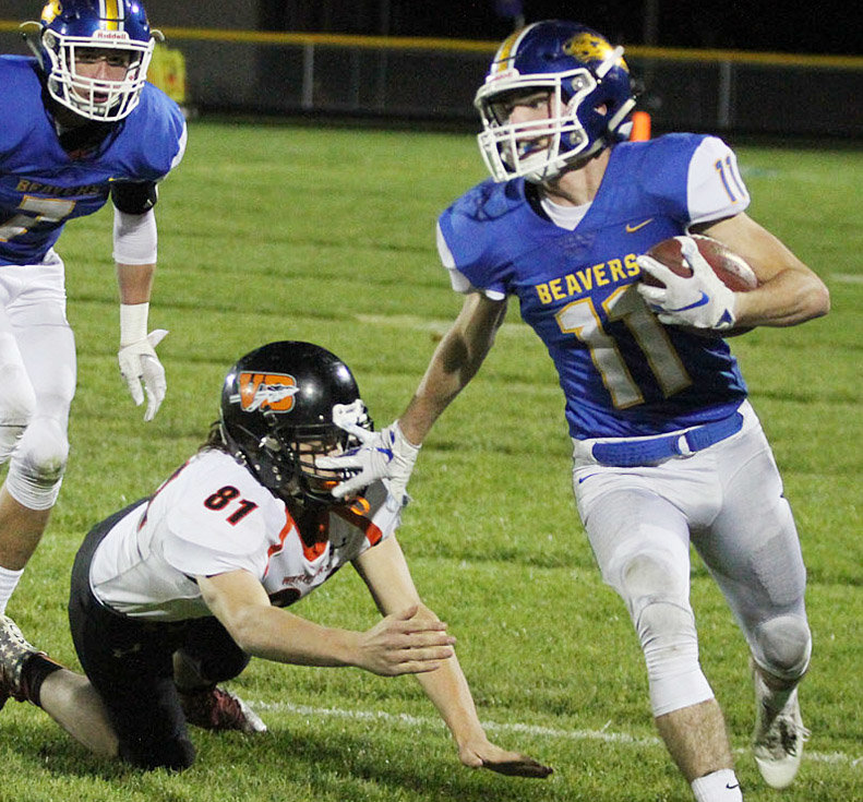 Wilton's Cory Anderson sheds a Van Buren defender in home action Oct. 19. The Beavers won 60-0 to secure an undefeated 5-0 district record and 8-1 overall mark. Wilton will host Pella Christian (6-3) in opening round playoff action Oct. 26.