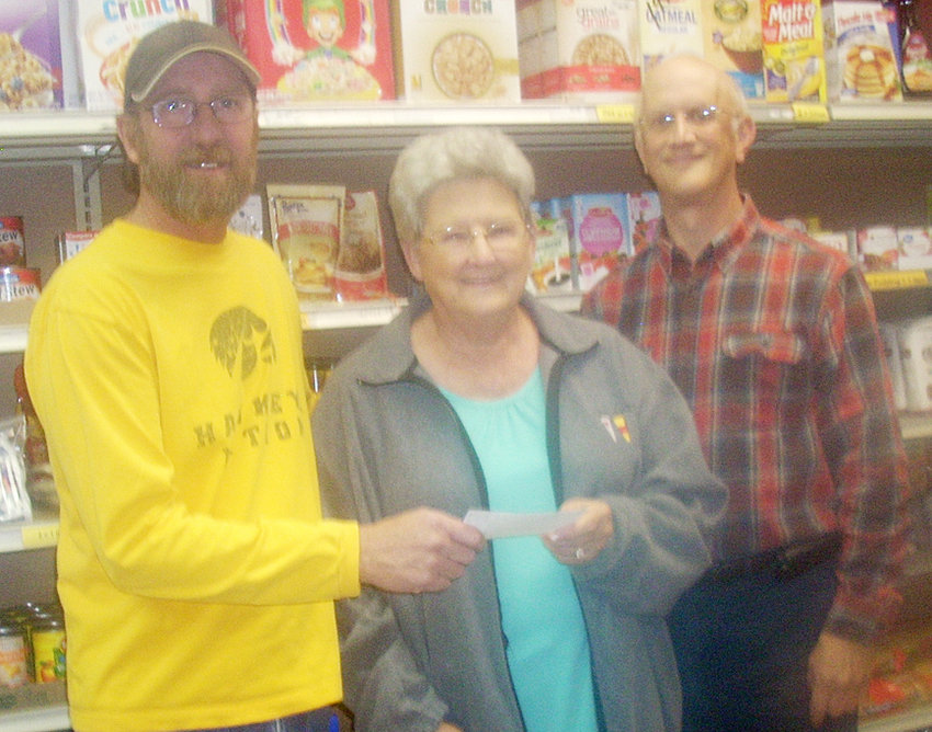 The Durant-Wilton Food Pantry received a substantial donation from Fro's, which held a fundraiser during their final bike night of the season. Pictured from left are Fro's owner Brian Froelich, Cookie Paper and food pantry treasurer Jon Koppenhaver.