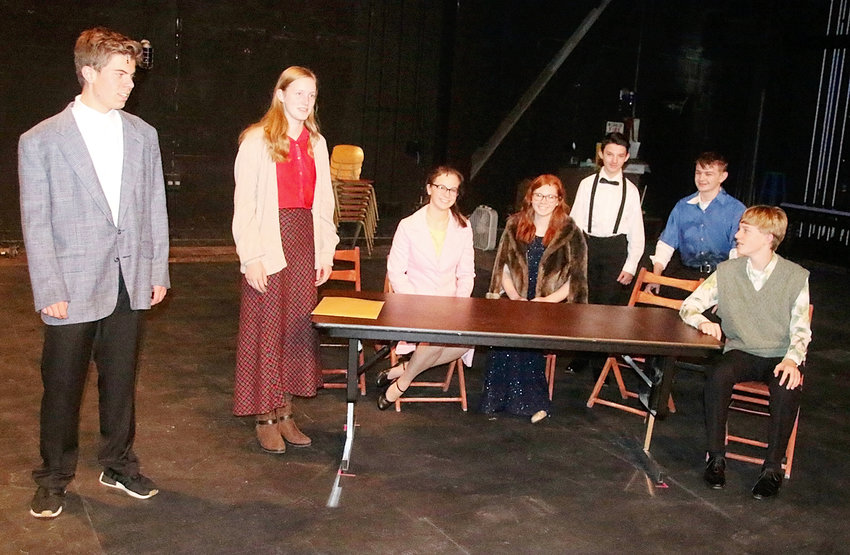 Rehearsing a scene are (l-r) Cooper Harrison, Aviana Holst, Bethany Schwarz, Kaitlyn Bendickson, Eliot Morrow, Ethan Windt and Connor Oetzmann.