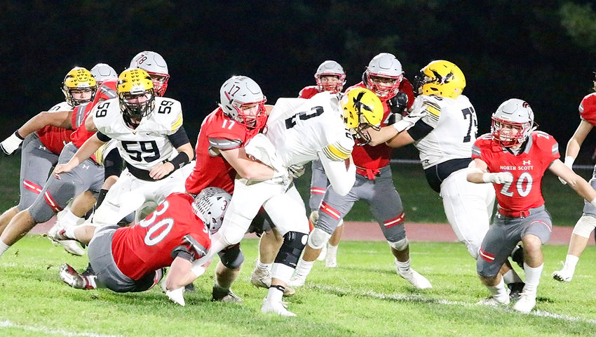 Lancer senior Sam Erickson goes low and junior Griffin Wilder takes the high road to bring down WSR quarterback Luke Velky.