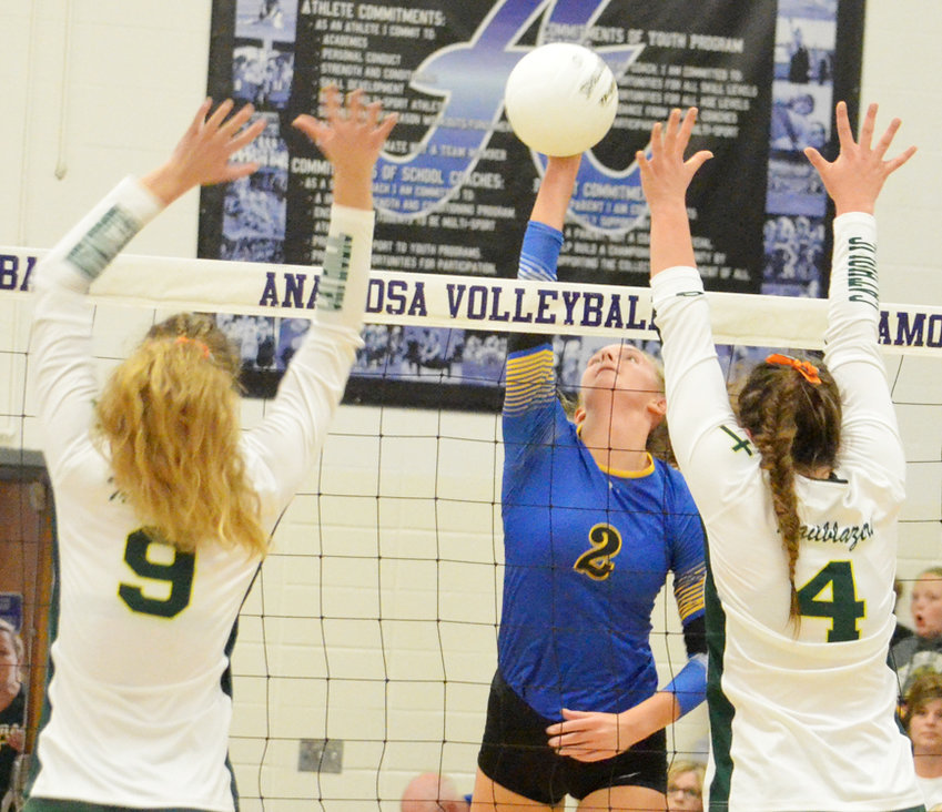 Durant senior Aubrin Dittmer attempts a kill between Beckman defenders in Regional final action at Anamosa Oct. 30. The No. 2 ranked Trailblazers defeated Durant 3-0 to secure a trip to state, where they'll face Wilton. Durant's season ended with a 26-9 overall record.
